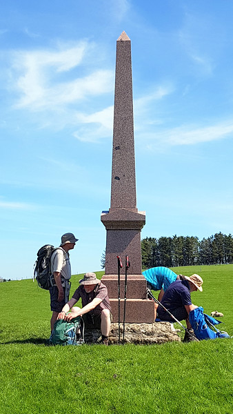 A memorial obelisk adjacent to the path on Cwm Whitton Hill.