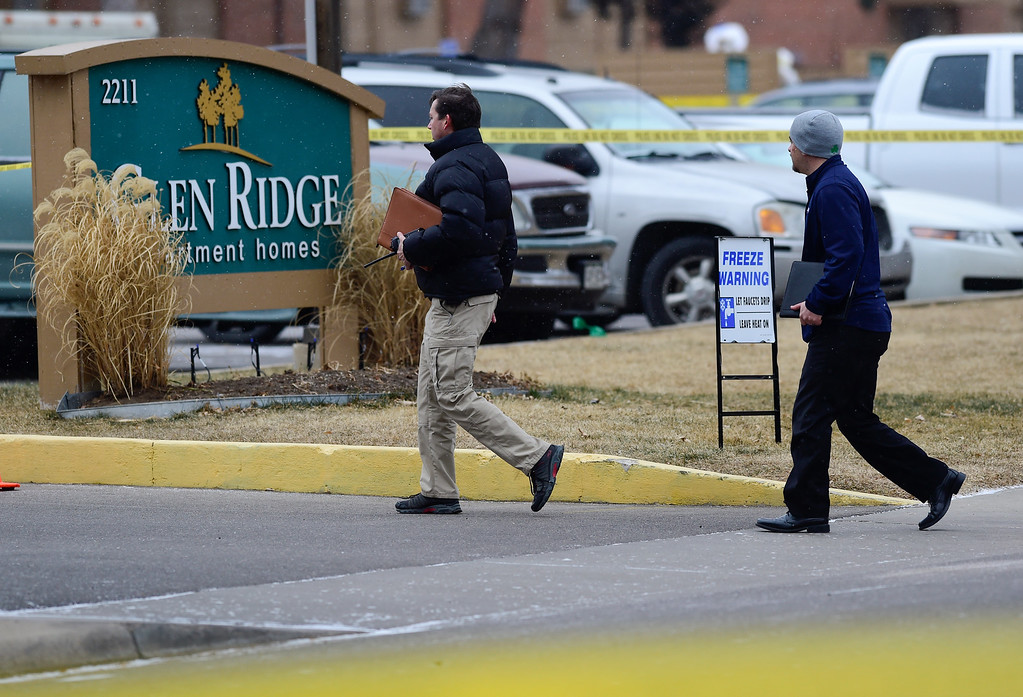 . LONGMONT, CO - DECEMBER 31:Investigators are seen near the entrance to the Glen Rige apartments on the scene of a fatal officer involved shooting on the 2200 Block of Pratt Street in Longmont on Dec. 31, 2018. (Photo by Matthew Jonas/Staff Photographer)
