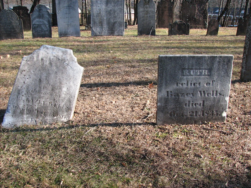 The gravestone of Bayze Wells on the left, and that of his wife on the right