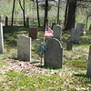 Caverly's grave is marked with a flag. It is in the center of the front row in this cemetery in which the rows are not aligned with the street.