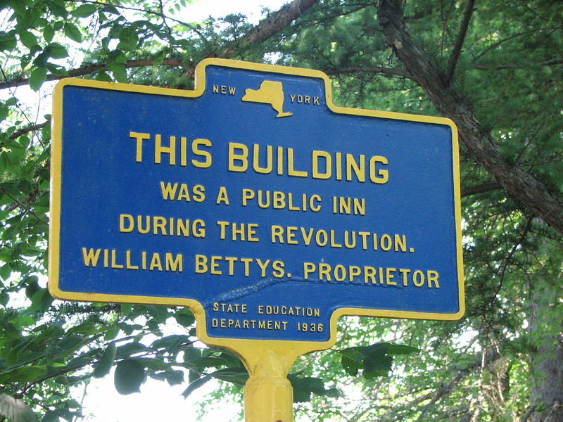 Historical marker which is hard to find, as it is among overgrown trees in front of the house which once served as the Battys family's inn.
