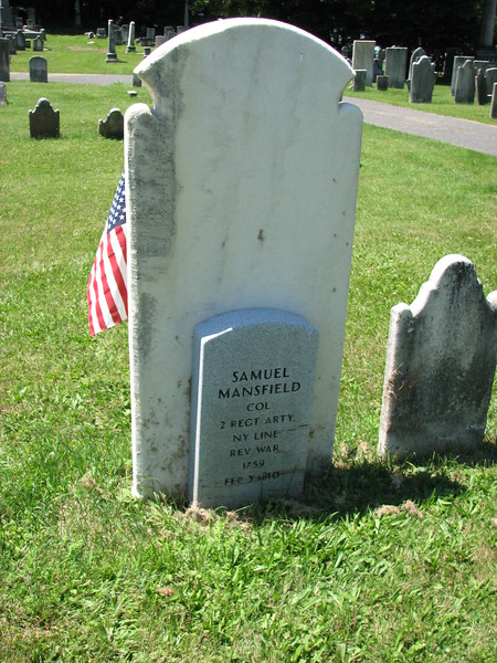 The small modern marker against the back of the original stone