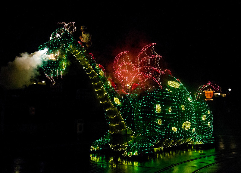 """A COLORFUL HOMECOMING – The Elliot dragon float from the classic 1977 Disney film """"Pete's Dragon"""" travels down the parade route at Disneyland park for the return of the Main Street Electrical Parade. The massive float decorated in thousands of twinkling green lights weighs 5,600 pounds, and measures 16 feet tall, 10 feet wide and 38 feet long.  The Main Street Electrical Parade will run for a limited-time, through June 18, 2017, at Disneyland park. (Scott Brinegar/Disneyland)"""