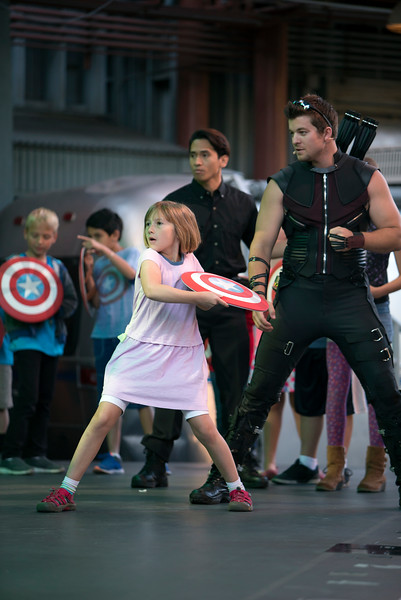 RECRUITS IN TRAINING — An aspiring young Avenger trains with the master archer Hawkeye in the interactive show Avengers Training Initiative at Disney California Adventure Park. Guests will find excitement throughout Hollywood Land during Summer of Heroes with the Avengers Training Initiative featuring Black Widow and Hawkeye, and heroic encounters with Black Widow, Captain America and Spider-Man. (Joshua Sudock/Disneyland Resort)