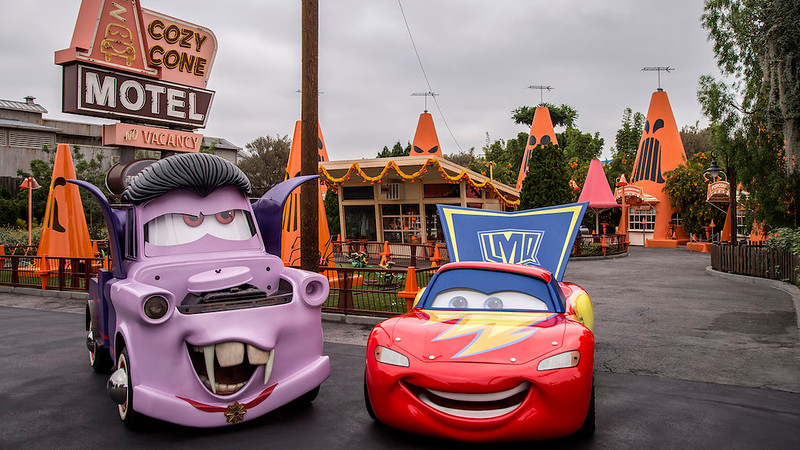 """CARS LAND HAUL-O-WEEN - Everyone's favorite Cars characters have transformed Radiator Springs into their own Haul-O-Ween celebration during Halloween Time at the Disneyland Resort. For the first time, the Cars characters will be donning their Halloween """"car-stumes"""" as they greet guests and prepare to go """"trunk-or-treating."""" Mater will be wearing his vampire or """"van-pire"""" outfit, while Lightning McQueen is dressed as a super hero. Cruz Ramirez, Red the Fire Truck and DJ get dressed up as a pirate, a clown and a punk rocker, respectively.(Joshua Sudock/Disneyland Resort)"""