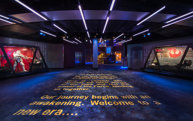 """STAR WARS LAUNCH BAY -- In the heart of Tomorrowland, Star Wars Launch Bay is the central locale for guests to celebrate all things Star Wars. Disneyland park guests are welcomed to this multi-sensory space with the iconic phrase, """"A long time ago in a galaxy far, far away.…"""" Once inside, they may encounter beloved Star Wars characters, play the latest Star Wars interactive video games, explore galleries full of treasured memorabilia and authentic replicas of large-scale Star Wars artifacts, step into a Star Wars-themed cantina, and have access to Star Wars merchandise. (Paul Hiffmeyer/Disneyland Resort)"""