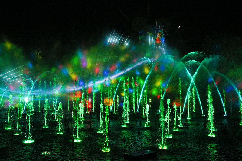 """WORLD OF COLOR - SEASON OF LIGHT -- """"World of Color - Season of Light"""" brings the warmth and heartfelt spirit of the holidays to this stunning, nighttime water spectacular, with its 1,200 powerful fountains shooting water as high as 200 feet to help tell the story. The show's musical soundtrack features some well-known musical artists performing popular holiday tunes, including """"Let it Snow"""" by Dean Martin and """"Baby, It's Cold Outside"""" by Michael Buble and Idina Menzel. With classic holiday music, humor and memorable moments from Disney animated films, this becomes an ideal way for guests to conclude their holiday visit. (Scot Brinegar/Disneyland)"""