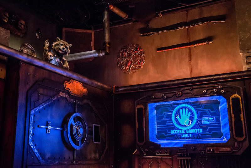 """Guardians of the Galaxy–Mission: BREAKOUT! — Rocket, known for his uncanny ability to break out of any confined space or prison, emerges in the private office of The Collector to help guests free his fellow Guardians. The epic new attraction Guardians of the Galaxy–Mission: BREAKOUT! at Disney California Adventure park blasts guests straight into the """"Guardians of the Galaxy"""" story for the first time, alongside characters from the blockbuster films and comics.  (Joshua Sudock/Disneyland Resort)"""
