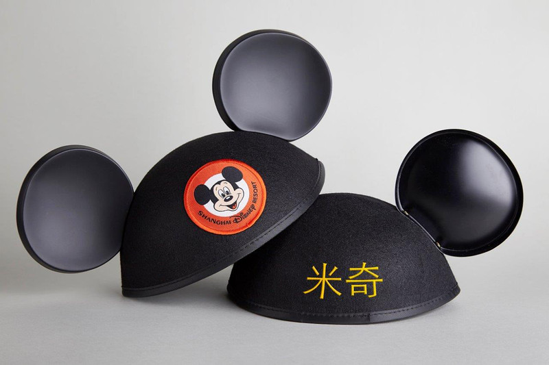 The first steps into Shanghai Disneyland, leads you to the whimsical and lively neighborhood on Mickey Avenue. Guests entering the park will leave their worlds behind and enter the hometown of Mickey and his friends, the first entrance of its nature.This includes sophisticated shopping areas where guests can get Chinese names embroidered on iconic Mickey ear hats - a first for Disney theme parks throughout the world. (Todd Anderson, photographer)