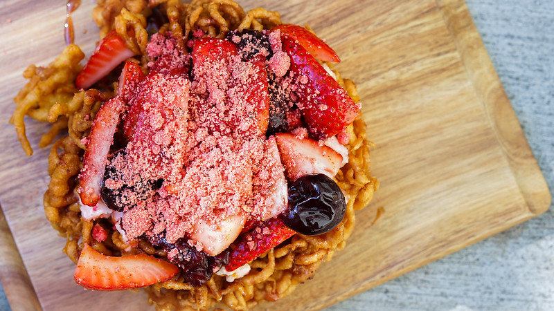"""Lots-o'-Straw-""""Bear""""-y Funnel Cake (Strawberry-cherry topping, strawberry butter and streusel, with spiced syrup drizzle) – Hungry Bear Restaurant, Disneyland park"""