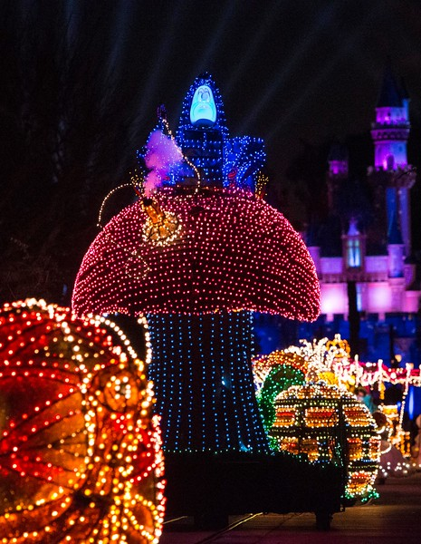 """A COLORFUL HOMECOMING – Beloved characters from the classic 1951 Disney film """"Alice in Wonderland,"""" including Alice and the Caterpillar aboard illuminated mushroom floats, entertain guests during the Main Street Electrical Parade at Disneyland Park. The Main Street Electrical Parade will run for a limited-time, through June 18, 2017, at Disneyland park. (Scott Brinegar/Disneyland)"""