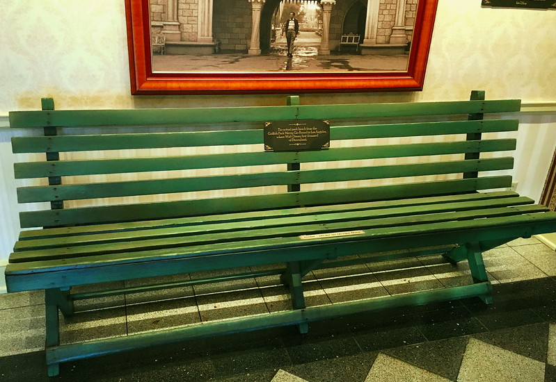 """Display at The Walt Disney Family Museum in San Francisco. The inscription on the bench reads: """"The actual park bench from the Griffith Park Merry-Go-Round in Los Angeles, where Walt Disney first dreamed of Disneyland."""" (Photo: Sam Howzit)"""