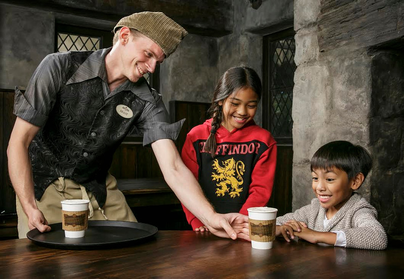 """""""The Wizarding World of Harry Potter"""" now serves hot Butterbeer at Three Broomsticks."""