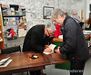 The author, Dr. Alan O'Rourke signs a copy of his book. Sun 24.11.13
