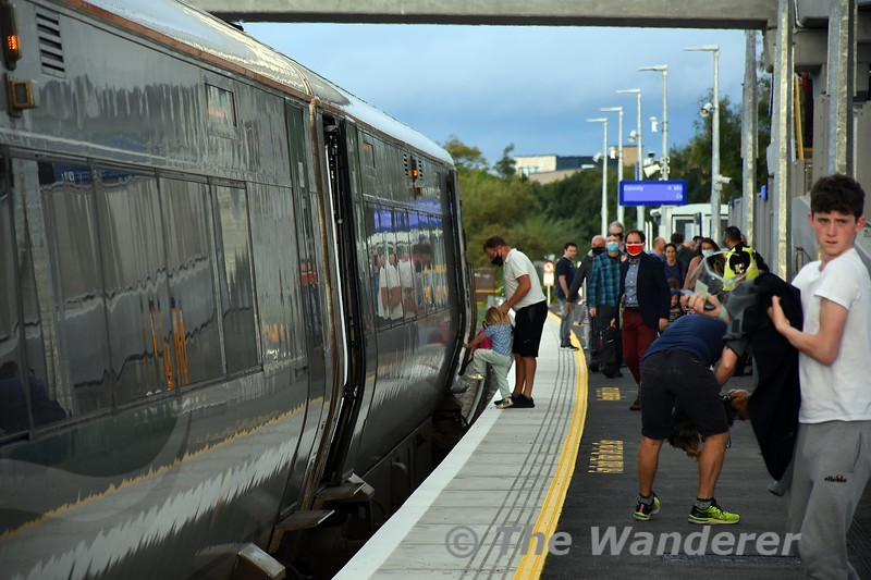 22021 arrives into Pelletstown with the 0807 Maynooth - Connolly, the first train to call at the new station. Passengers board the first train. Sun 26.09.21