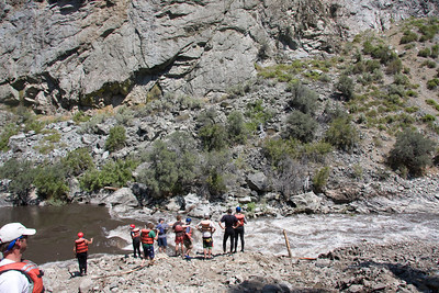 Scouting the new rapid.  Notice the steepness of the fan as I am not too far back from the group at river's edge.