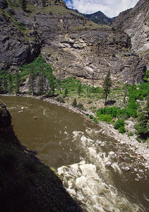 Looking onto Wall Creek Rapid with large outcrops of Idaho Batholith Granite walls behind.