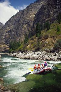 Large Idaho Batholith granite boulders clog the river at Weber Rapid.