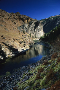 The tappan canyon contace (river left downstream) between the Casto Pluton granites and metamorphic gneiss.