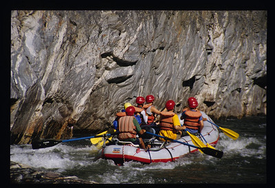 Rafting past a wall of water polished metamorphic gneiss.