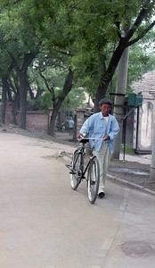 Man walking his bicycle, rural scene, China, 1990s