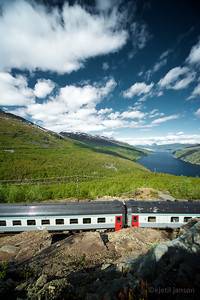 SJ SSRT passenger service in train 96 from Narvik to Boden, at Kvitur between Rombak and Katterat station, overlooking Rombak fjord and bridge, 2012-06-29 10:38. Photo: Kjetil Janson