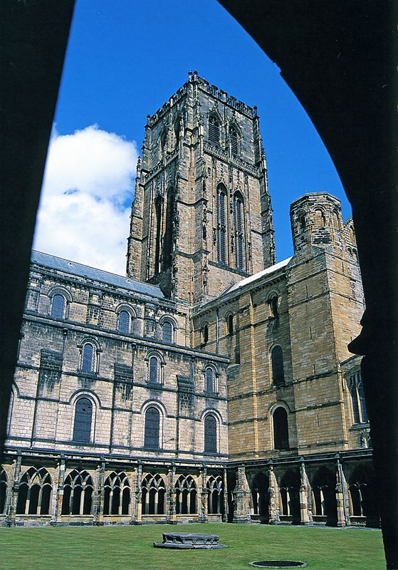 The Cloister looking north east at the Cathedral. Until the Reformation, Durham Cathdral was a Benedictine monastery and the seat of a Bishop. Bishop Flambard was noted as a defender of the English borders with Scotland, and he appointed Sir Robert Ogle as marshal of Norham Castle on the River Tweed near Berwick.