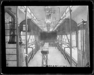 2009.018.01.049--Ohio Falls Car Mfg Co 9x6.75 cabinet card--New Orleans & North Eastern--mail sorting area interior of RPO car--Jeffersonville IN--no date