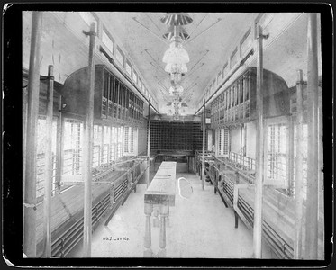 2009.018.01.040--Ohio Falls Car Mfg Co 9x7.25 cabinet card--Alabama Great Southern--mail sorting area interior of RPO car--Jeffersonville IN--no date