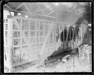 2009.018.01.002--Ohio Falls Car Mfg Co 9.5x7.5 cabinet card--unknown road--shop interior view of baggage car under construction--Jeffersonville IN--no date