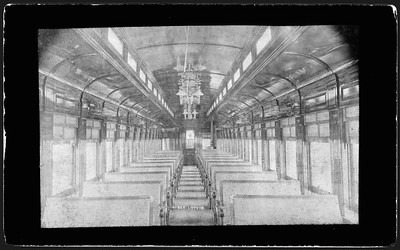 2009.018.01.054--Ohio Falls Car Mfg Co 7x4.25 cabinet card--PS&LE--interior view of passenger coach with rattan seats--Jeffersonville IN--no date