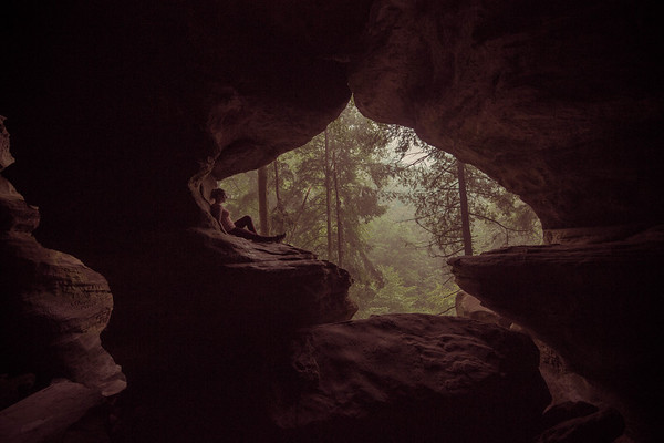 Rock House is the only true cave found in Hocking Hills State Park. Tucked 150 feet above ground inside a towering cliff wall of Blackhand sandstone, the 200-foot-long chamber features huge window-like openings.