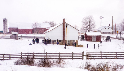 Amish children play in the schoolyard on a snowy day in Holmes County. Formal Amish education focuses on teaching hard work, ethical living and submitting to church and God. When schooling ends in the eighth grade, boys return home to hone farm skills or serve as apprentices in various trades, while girls help run family businesses or work outside the home as housekeepers, shop clerks or restaurant servers until they get married.