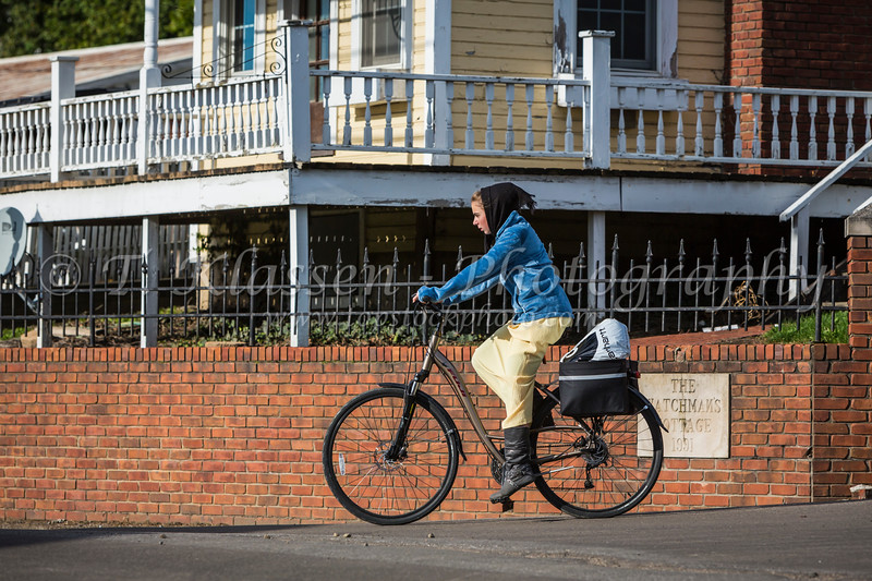 An Amish woman on a bicycle in Berlin, Ohio, USA.