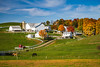 An Amish farm with house and barn near Charm, Ohio, USA.