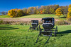 Parked buggies at a rural Coshocton County Amish church, Ohio, USA.