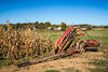 A corn picker in a corn field in rural Ohio, USA.