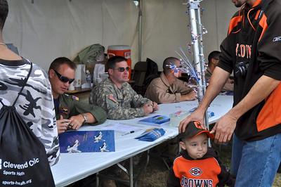 Armed Forces Pilots giving autographs