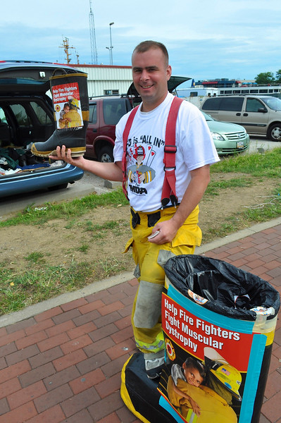 """""""Loot for the boot.""""  Firemen collecting for Muscular Dystrophy.  They covered the city rather well."""