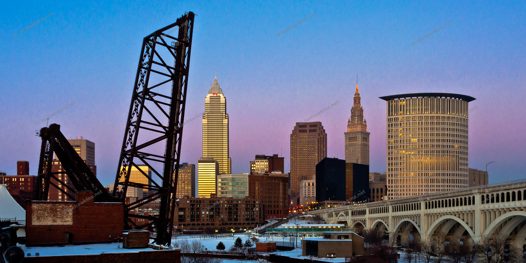 Downtown Cleveland during a winter sunset in 2011, one day after a storm deposited a sheet of ice across the existing blanket of snow, thus causing subtle blues in the sky to be reflected at dusk.  From L-R:  B&O Bridge #463, Key Tower, 200 Public Square, Terminal Tower, Stokes Tower, and the Veterans Memorial Detroit-Superior Bridge.