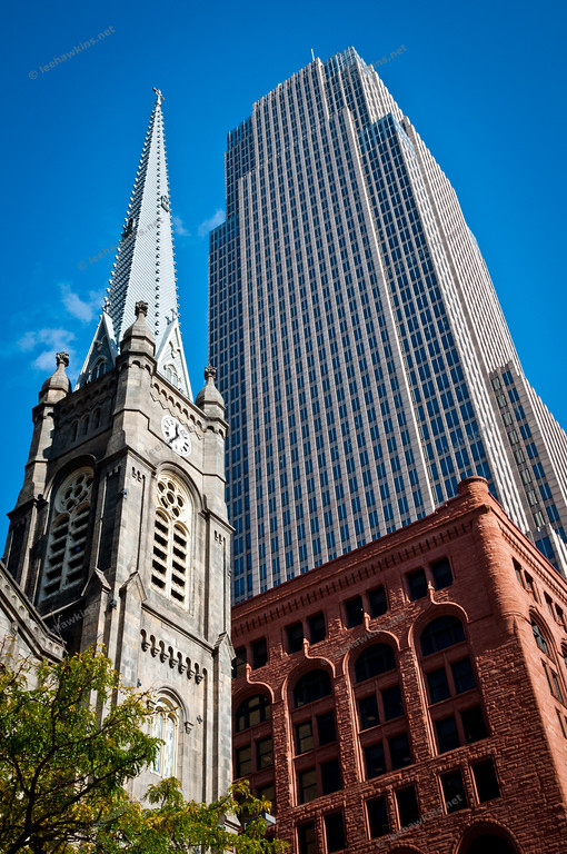 The steeple of the Old Stone Church, built in 1855, and Key Tower, completed in 1991 and the tallest building in Ohio, on Public Square in Downtown Cleveland.  Below is the Society For Savings Building, completed in 1890.