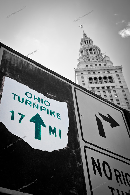 A sign directs motorists on Public Square in Cleveland to the Ohio Turnpike, the state's first superhighway and only toll road, constructed 1949-55.