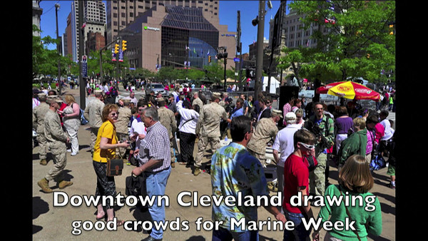 VIDEO:  Part 1 of 2.     Downtown Cleveland photos; martial arts trainers; dog handlers; Marines vs. Police/Fire 1st Responders in a flag football match at Cleveland Browns Stadium; Marching Band performs at Browns Stadium;