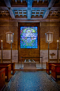 Interior of Wade Memorial Chapel in Lakeview Cemetery, featuring the beautiful Tiffany leaded stained glass window.