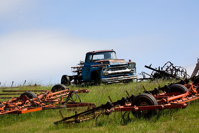 Old rusty truck and farm equipment in the Palouse.