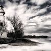A view of the lighthouse from the lake side, in black and white