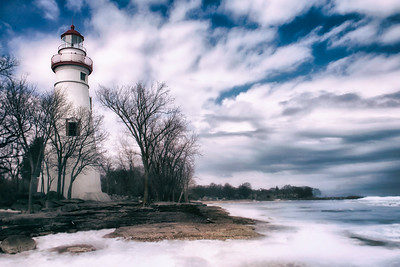 A view of the lighthouse from the lake side, in cool tones