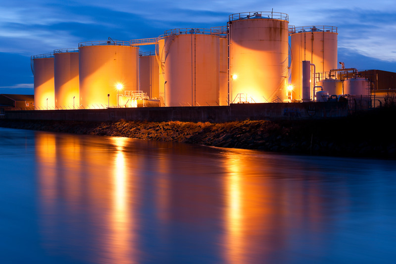 Fuel Tanks On The Bank Of The River <br /> illuminated at night