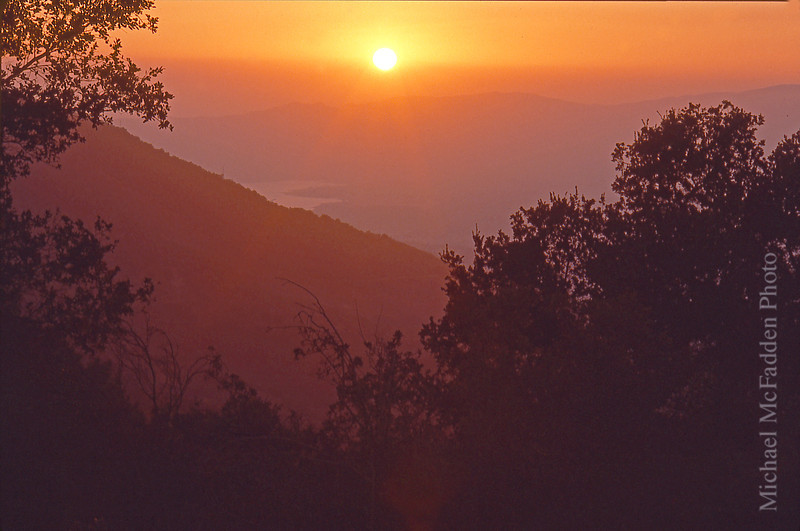 hazy fll sunset from sulfur mountain