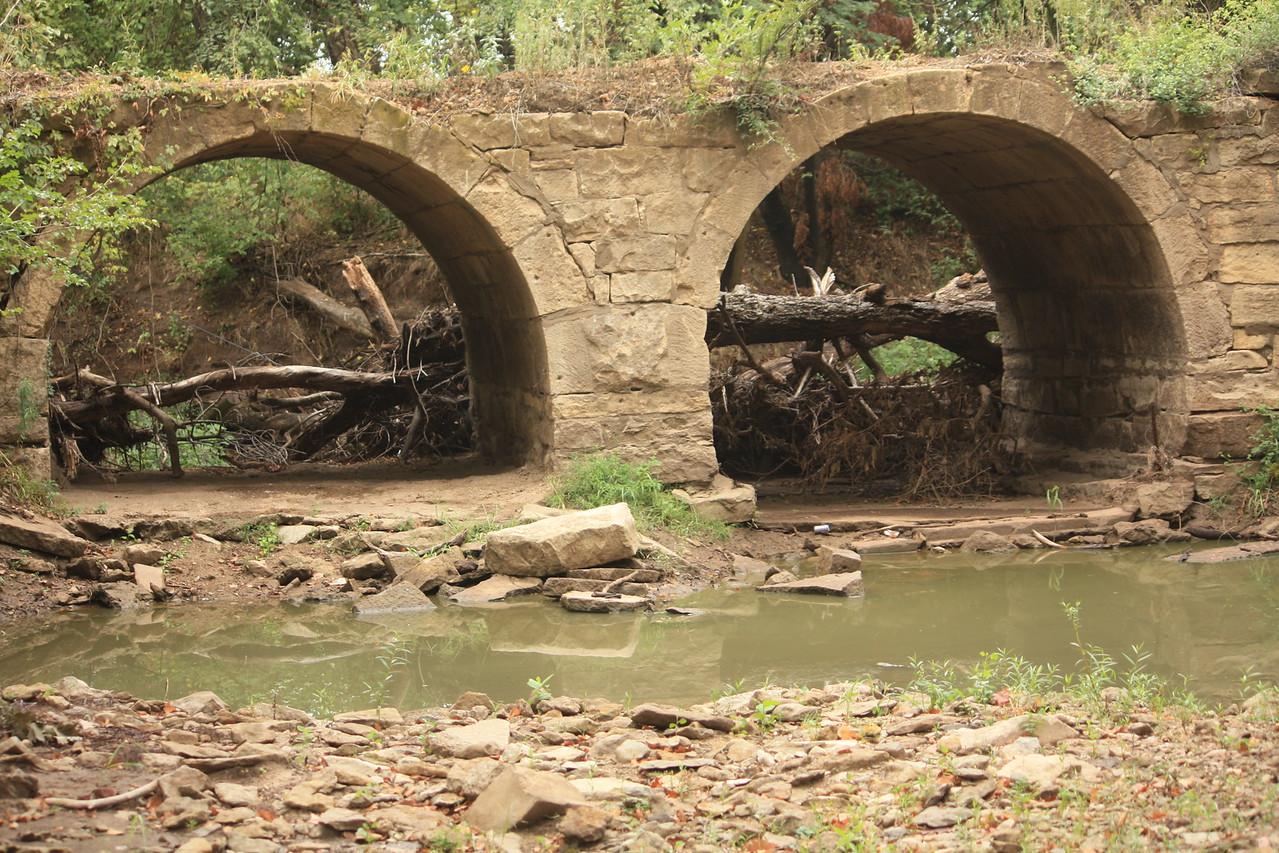 Double stone arch bridge over Deer Creek west of Kaw Lake. This photo taken by Karen.